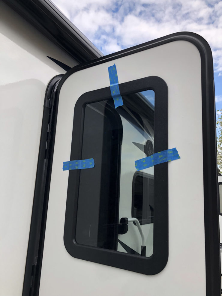 Photo of the outer frame and tinted glass taped into place
